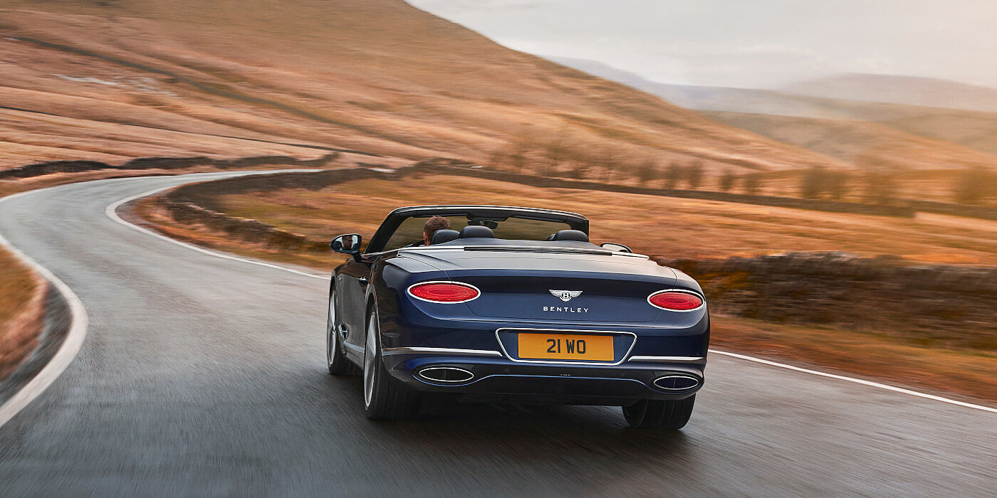 <new-bentley-continental-gt-speed-convertible-in-peacock- blue-rear-three-quarter-in-peak-district>